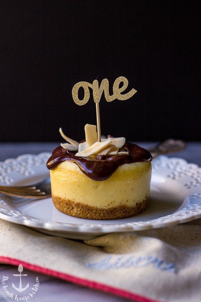 Vanilla Bean Cheesecake with Toasted Coconut Chip Crust Topped with Chocolate Ganache