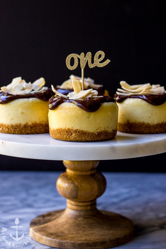 Vanilla Bean Cheesecake with Toasted Coconut Crust Topped with Chocolate Ganache