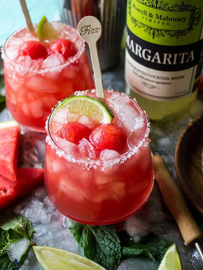 Watermelon Mint Margaritas on a tray with ice