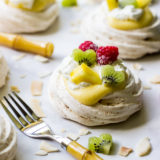 Coconut Pavlovas Topped with Pineapple Curd and Fresh Fruit