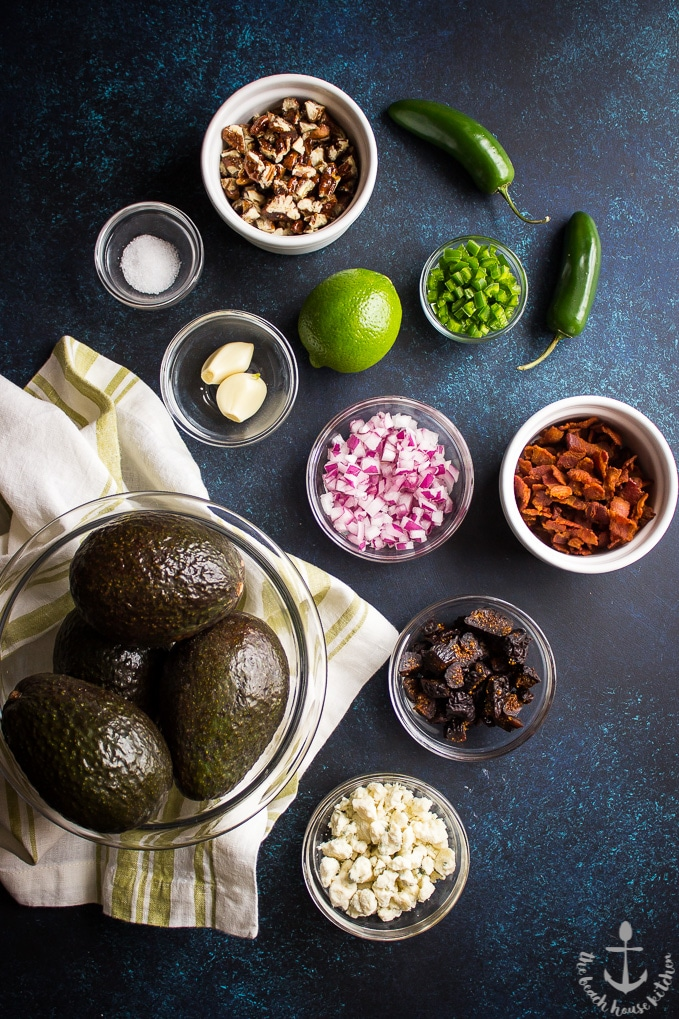 Overhead shot of ingredients in individual bowls for bacon fig guacamole.