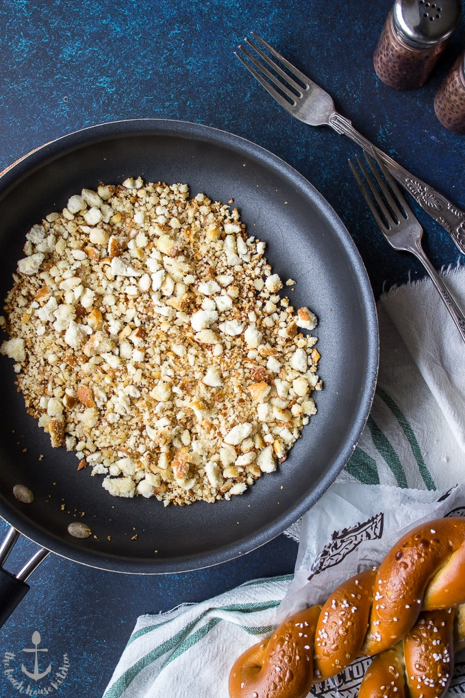 An overhead photo of a skillet filled with toasted soft pretzel crumbs.