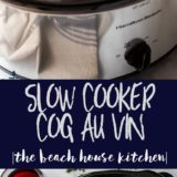 Slow Cooker Coq Au Vin in a silver crock pot with a bottle of wine and salt and pepper shaker in the background.
