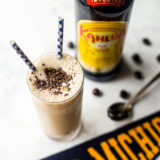 Boozy Coffee Milkshake with bottle of Kahlua and Michigan pennant in background
