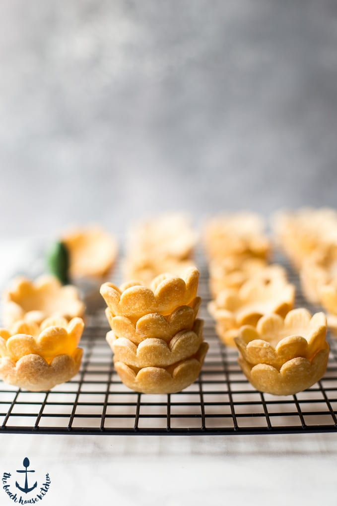 Mini Lemon Meringue Pie pie crust shells on a wire rack