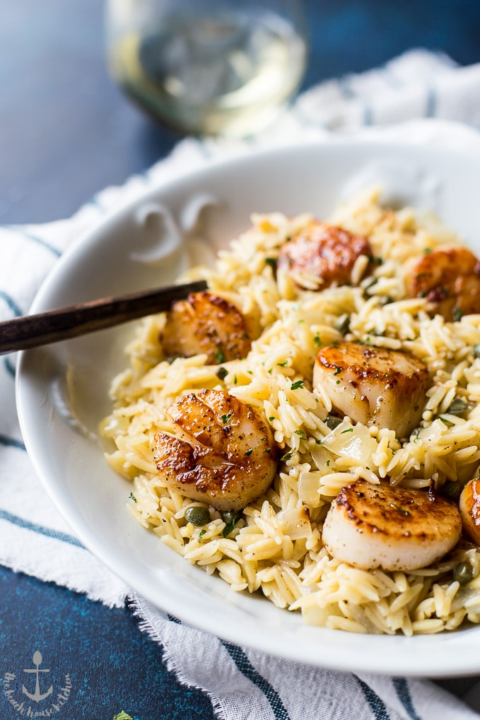 Closeup of the delicious pan seared scallops with orzo piccata looking extra inviting and yum