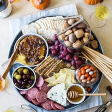 Holiday Cheese Board with Baked Brie with Bacon Onion Jam and Glazed Pecans
