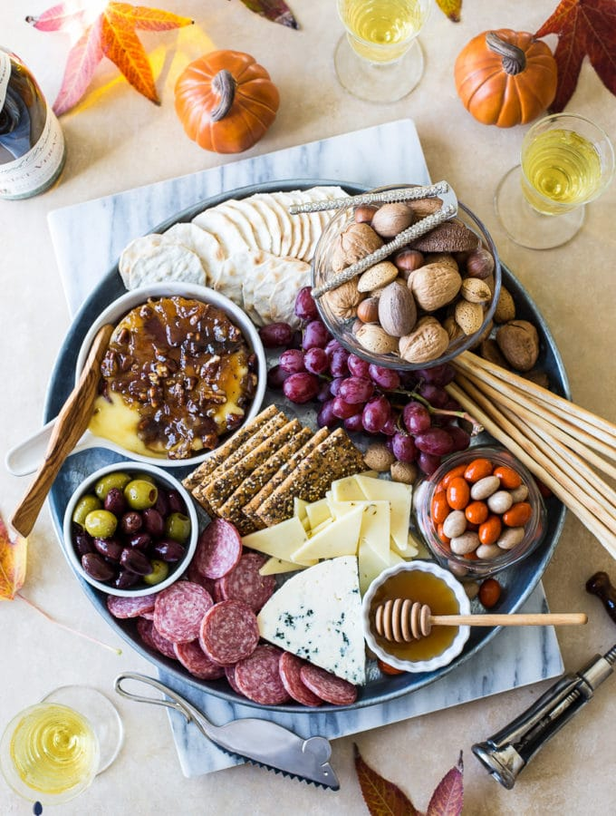 Holiday Cheeseboard with Bacon Onion Jam with Glazed Pecans Baked Brie