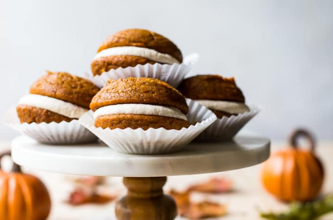 Pumpkin Whoopie Pies with Praline Buttercream on a marble cake stand