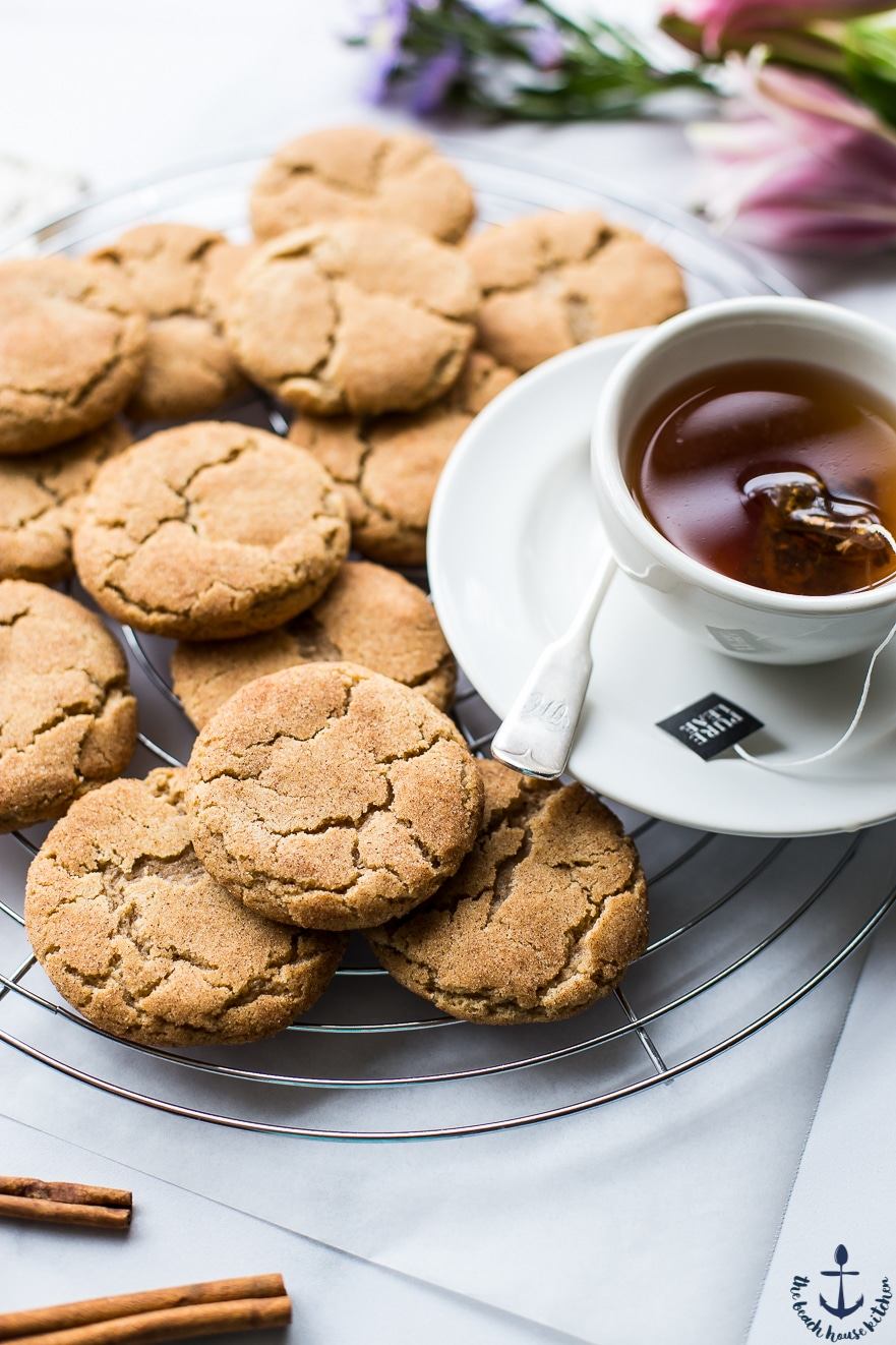 Chai Snickerdoodle Cookies on a wire rack with a cup of tea