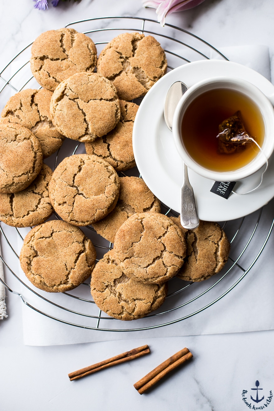 Overhead photo of Chai Snickerdoodle Cookies on a wire rack with a cup of tea