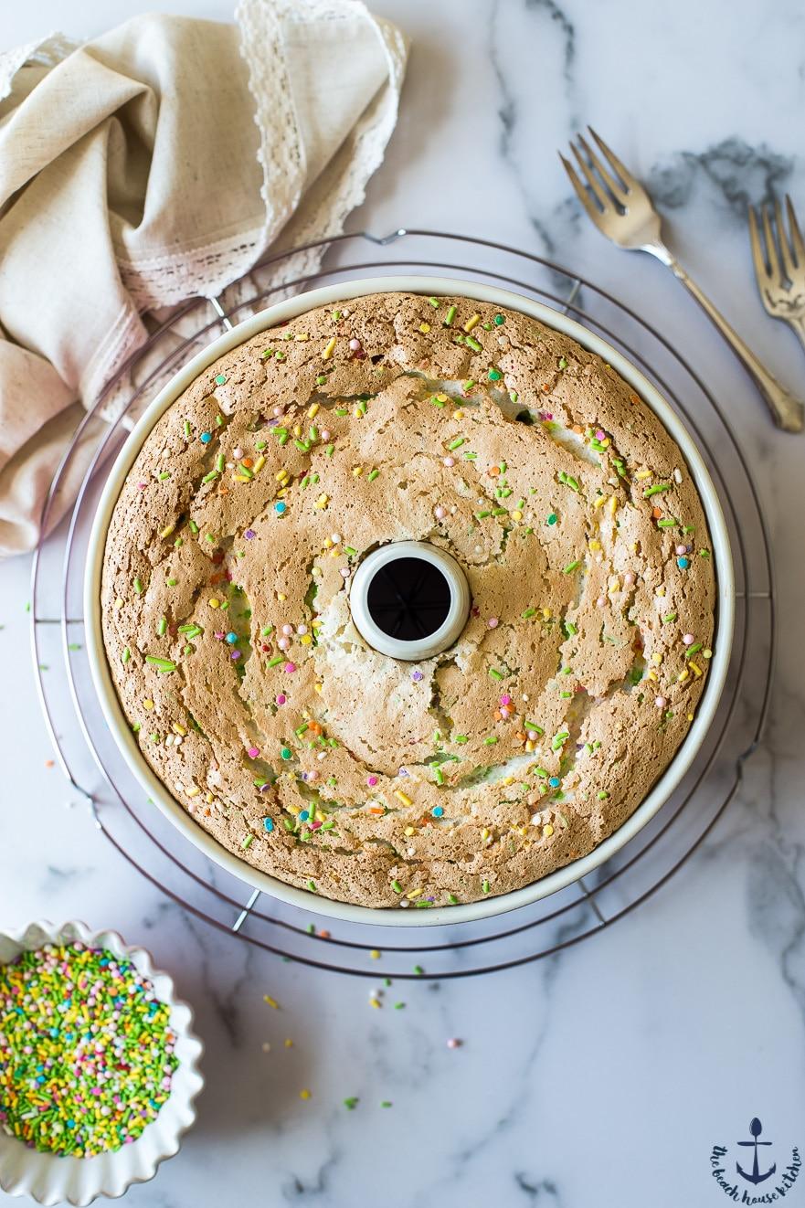 Funfetti Angel Food Cake on a round wire rack