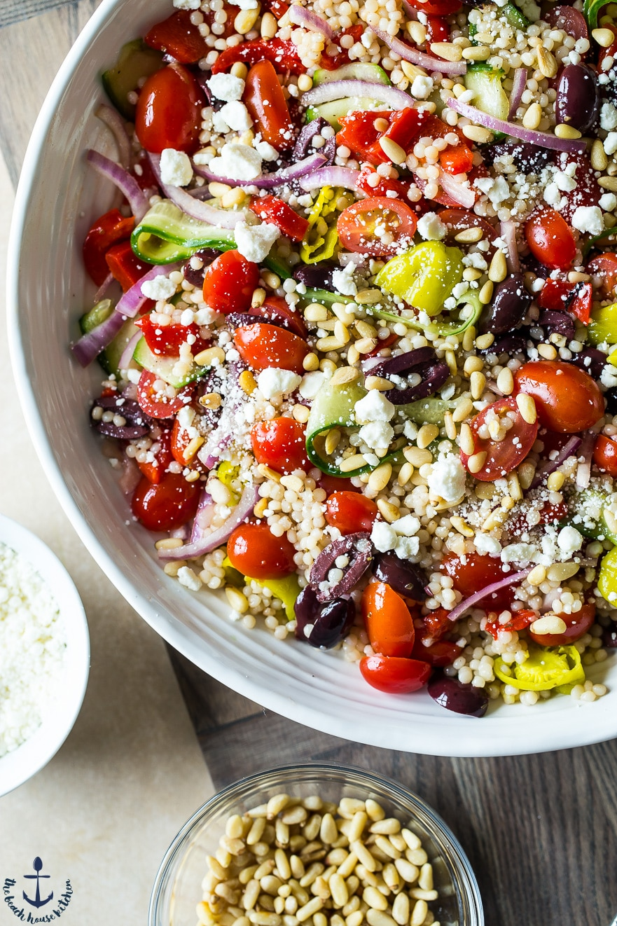 Overhead photo of Greek Couscous Salad in a white bowl