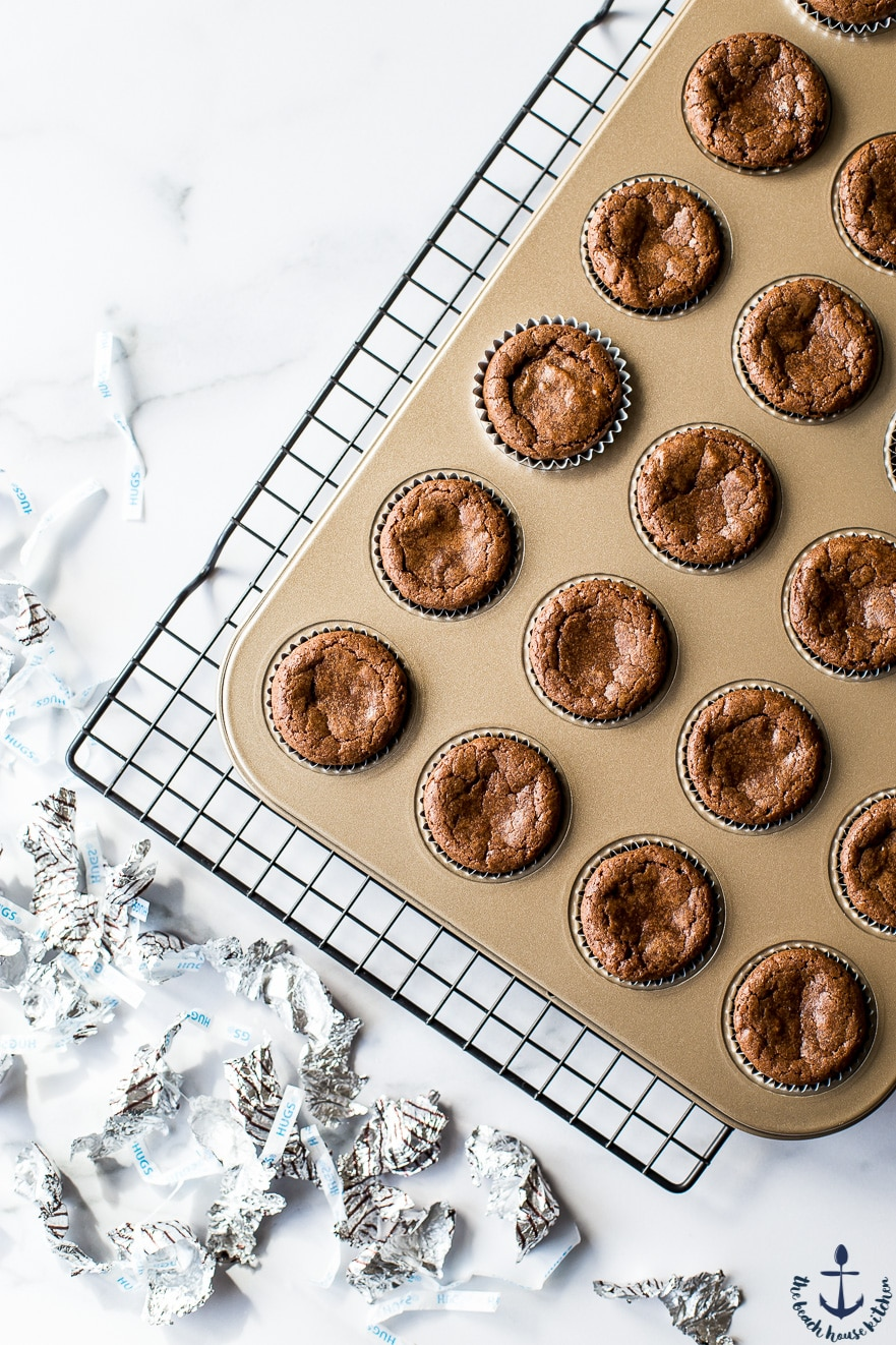 Overhead photo of brownie bites in gold muffin pan