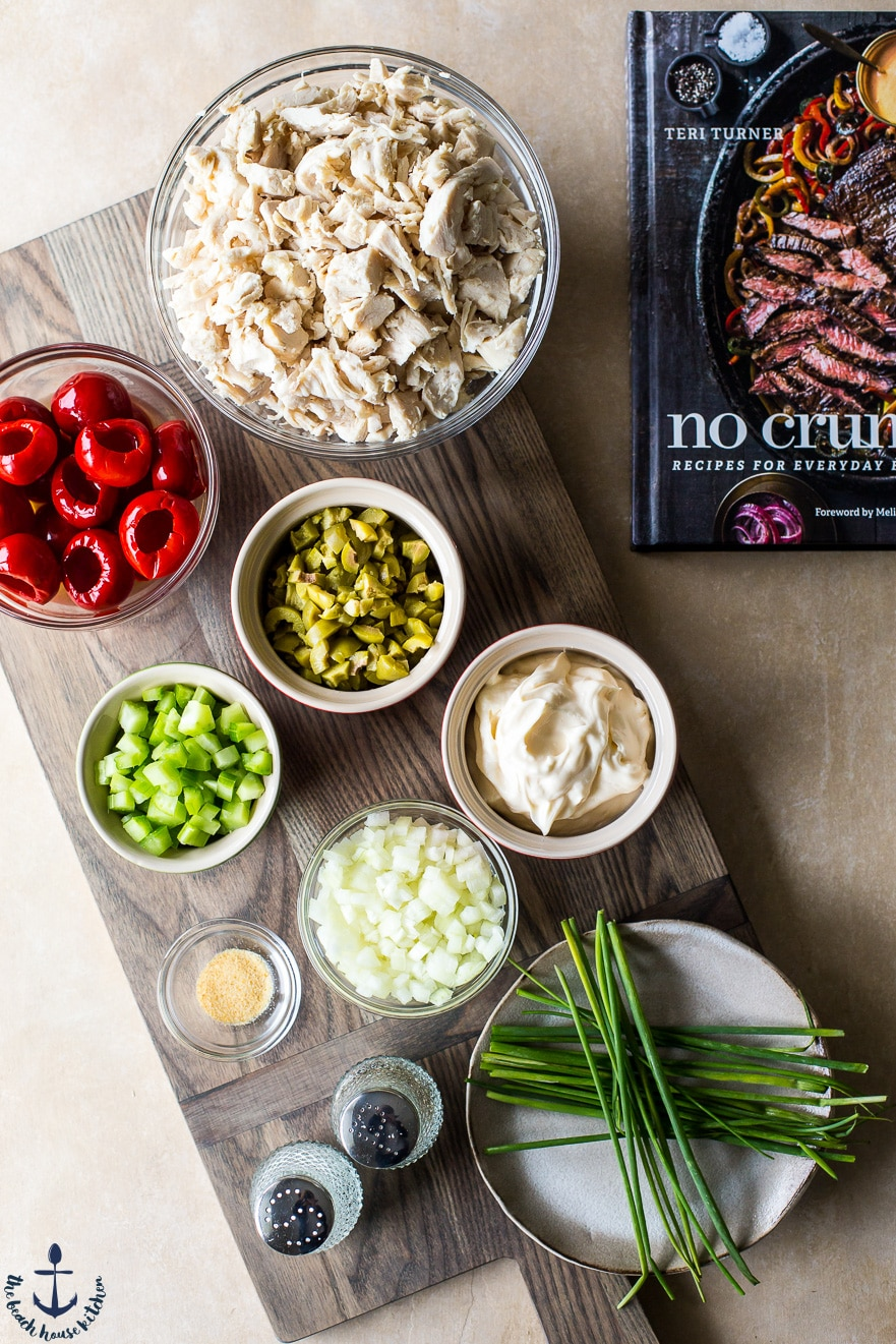Photo of ingredients for Chicken salad in bowls on wooden board