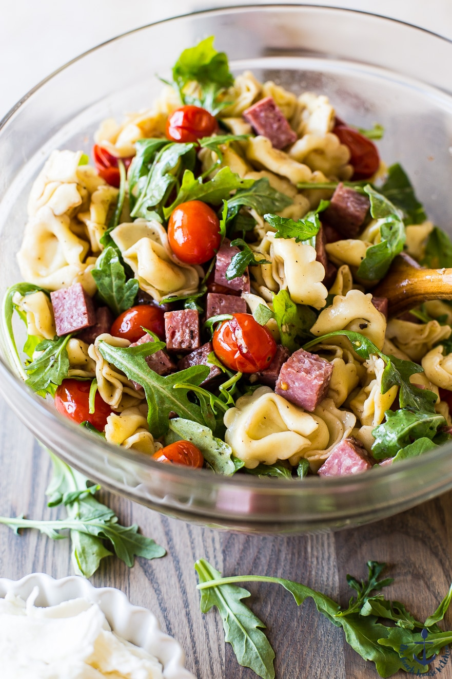 Photo of Tortellini, Roasted Tomato and Salami Salad in a clear bowl