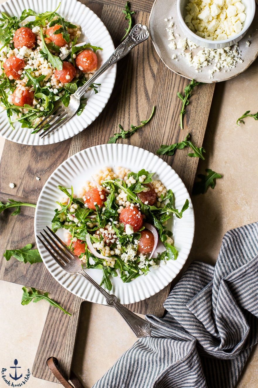 Overhead photo of Watermelon, feta and couscous salad on white plates