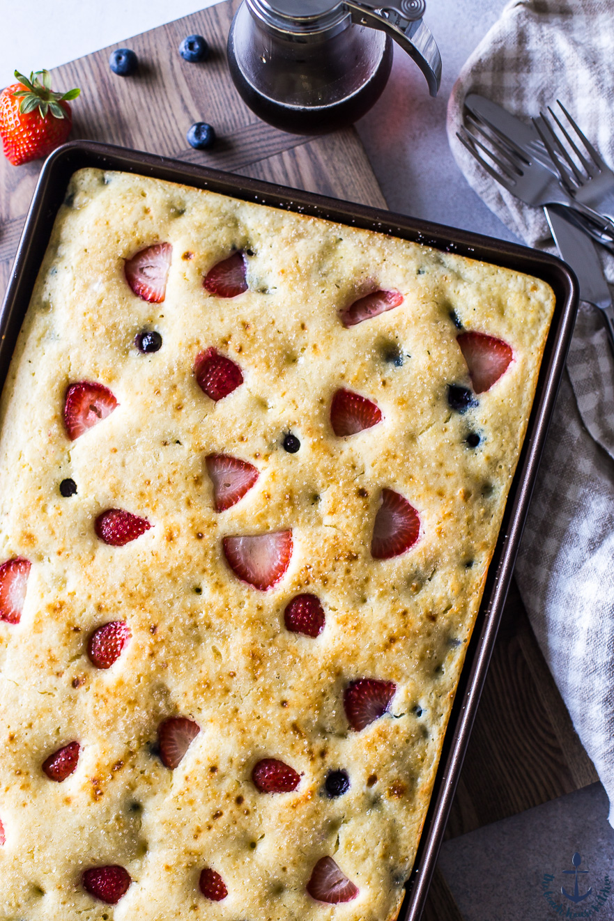 Overhead photo of berry buttermilk sheet pan pancake