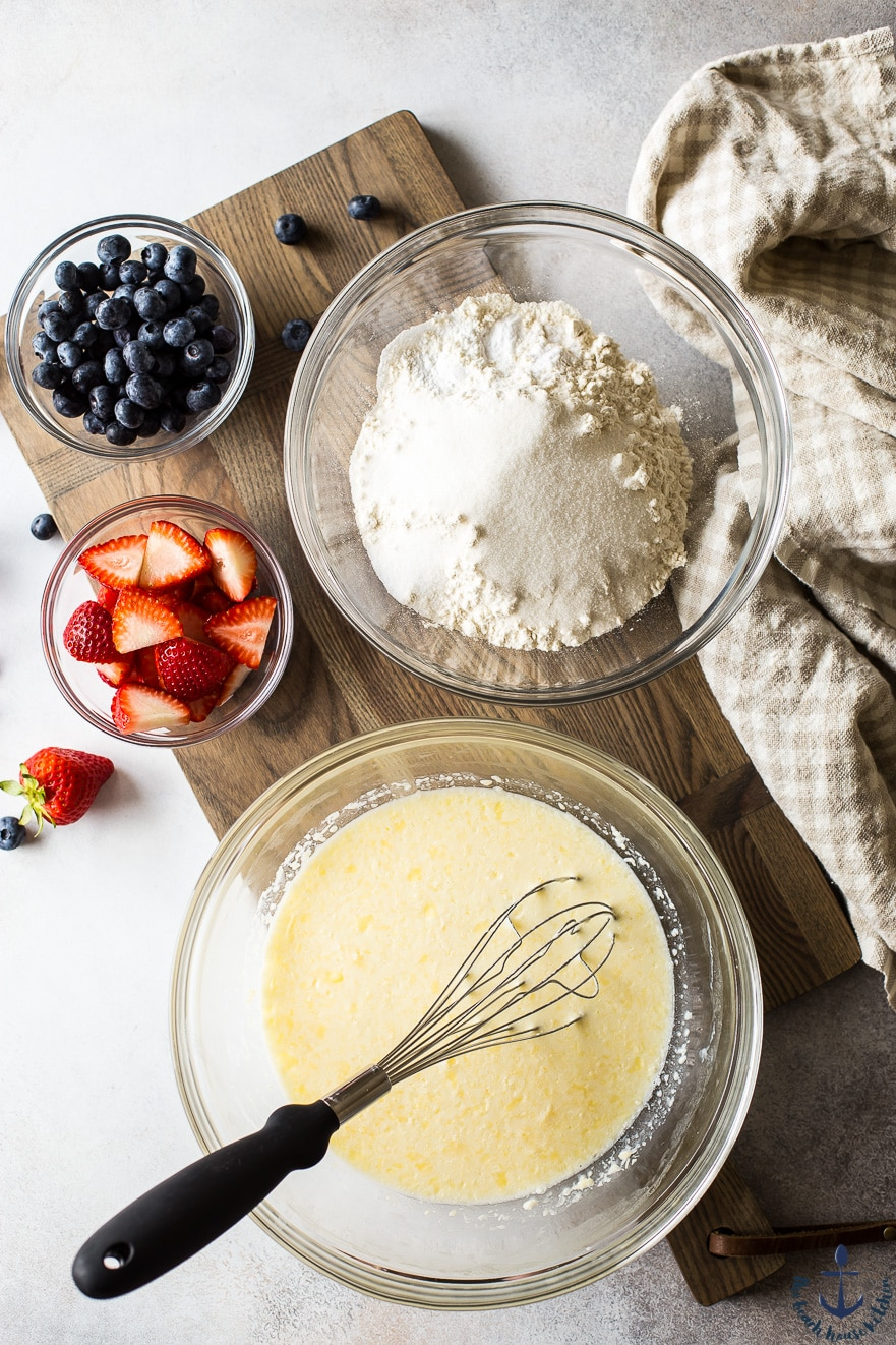 overhead photo of ingredients in bowls for berry buttermilk sheet pan pancakes