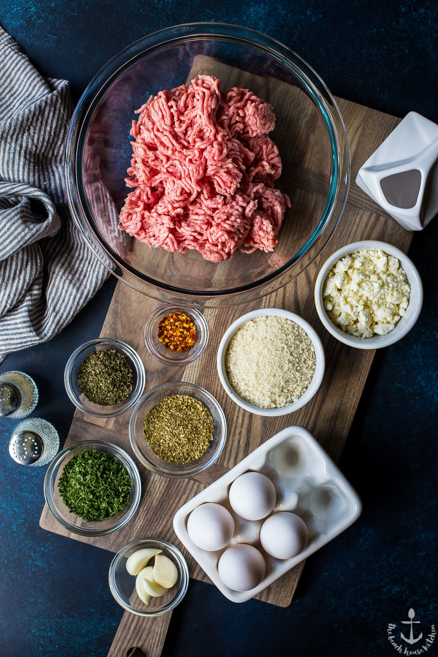 Overhead photo of ingredients for Greek meatballs in individual bowls
