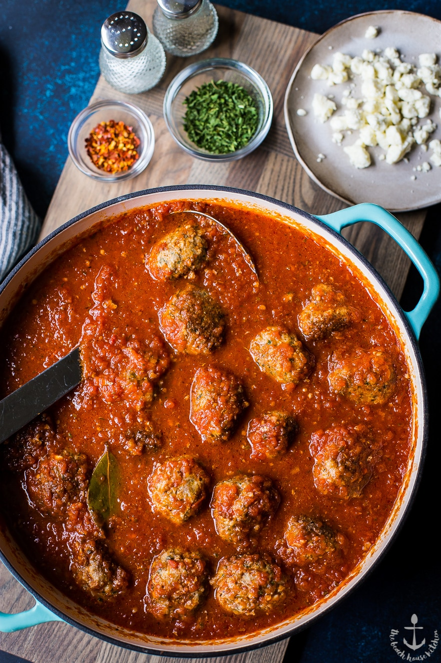 Overhead photo of Greek meatballs and gravy in a dish