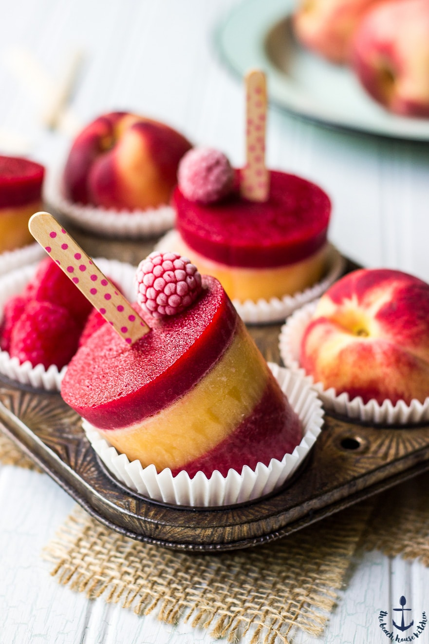 Raspberry Peach Popsicles in a muffin tin