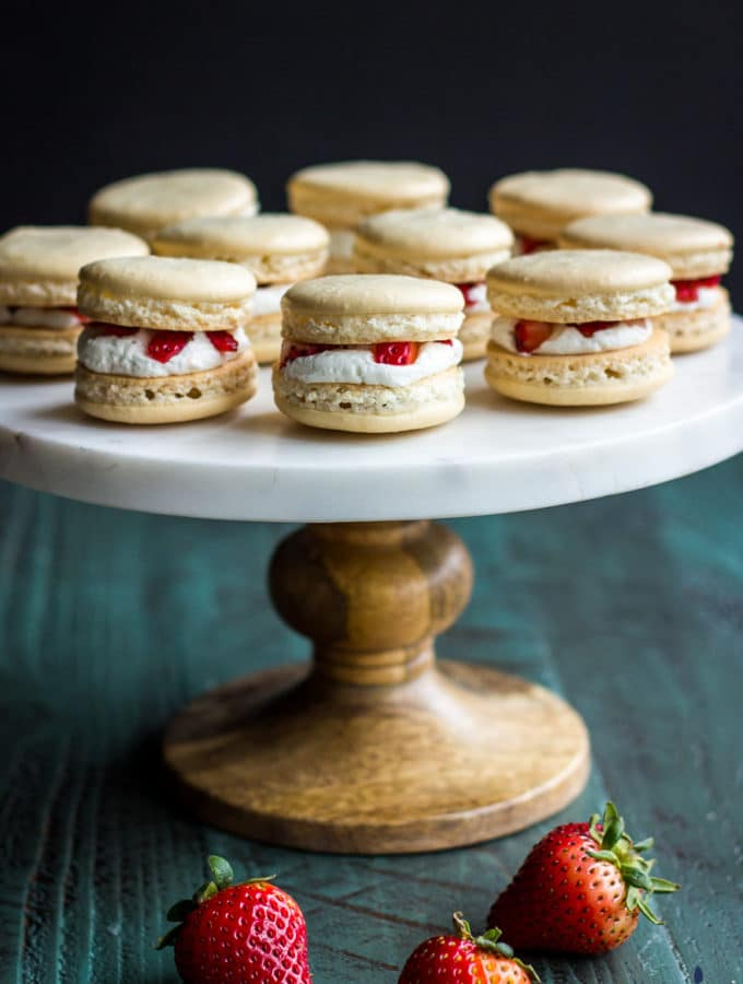 Cake stand topped with Strawberry shortcake macarons