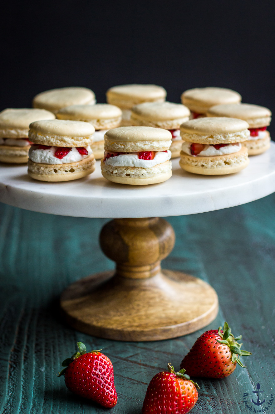 Strawberry Shortcake Macarons on a cake stand