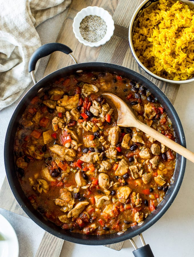 Overhead photo of Cuban spiced chicken and rice in a skillet