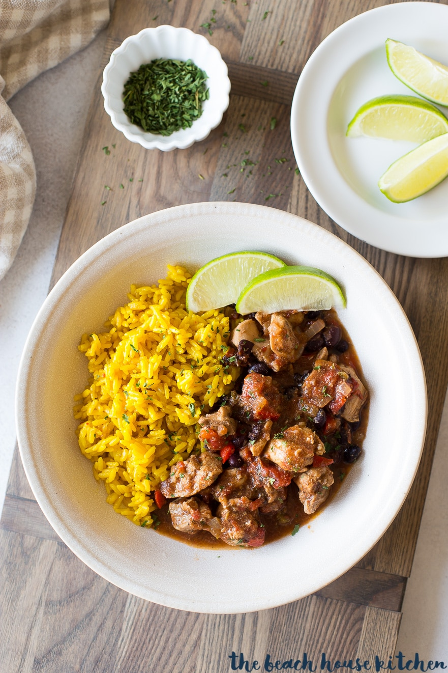 Overhead photo of Cuban spiced chicken and rice in white bowl