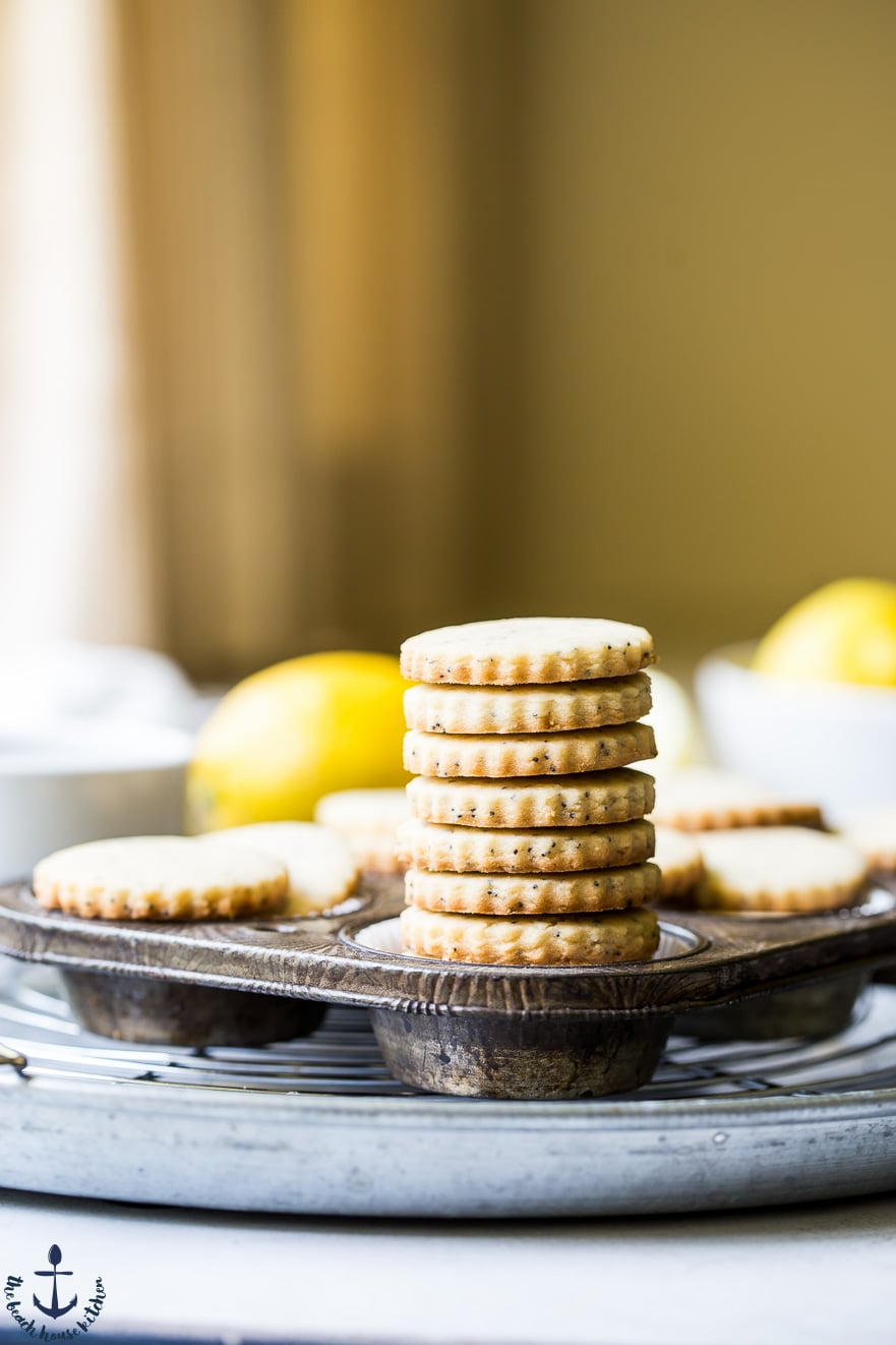 Stack of lemon poppyseed cookies in a muffin tin