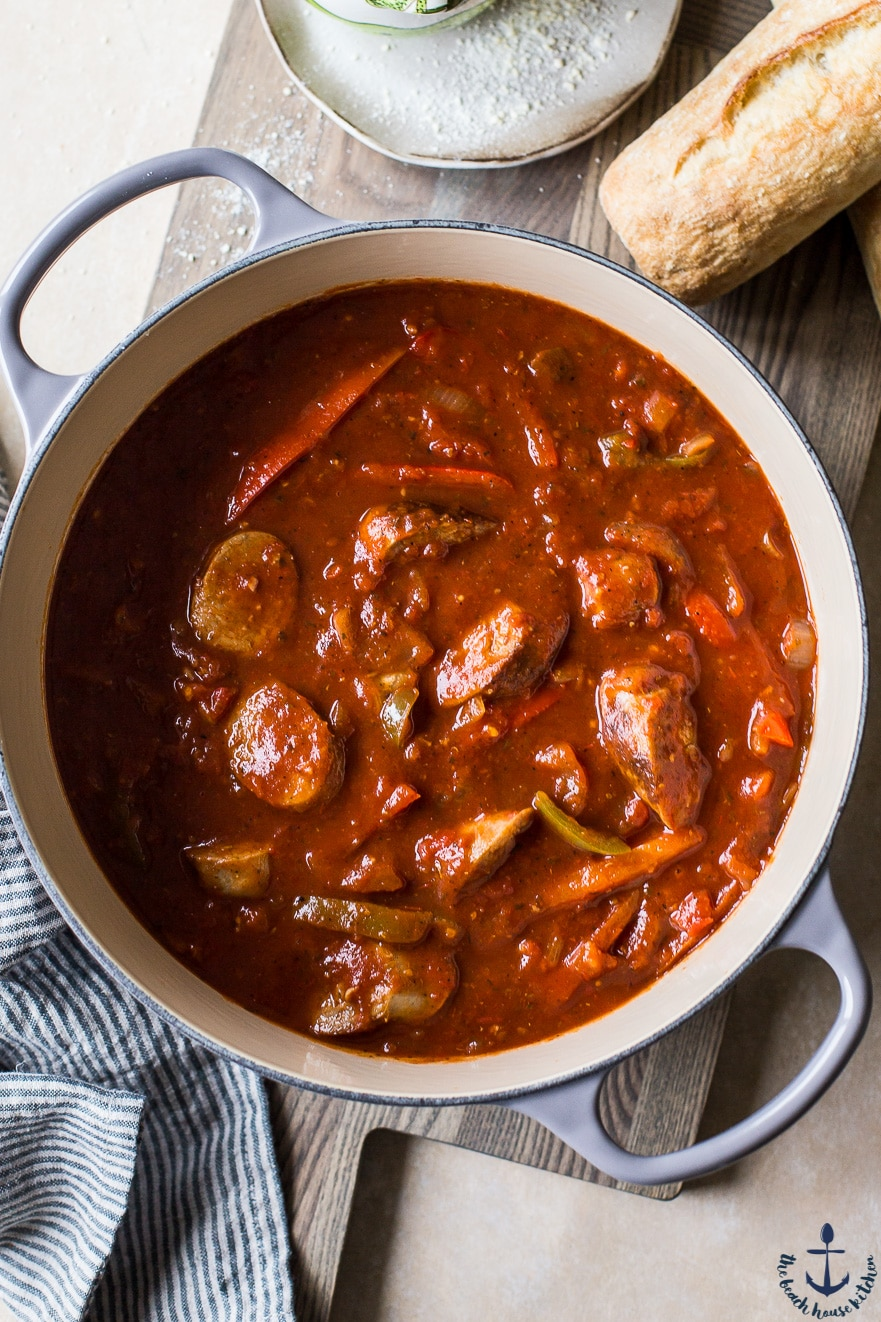 Overhead photo of Italian sausage, peppers and onions in a pot