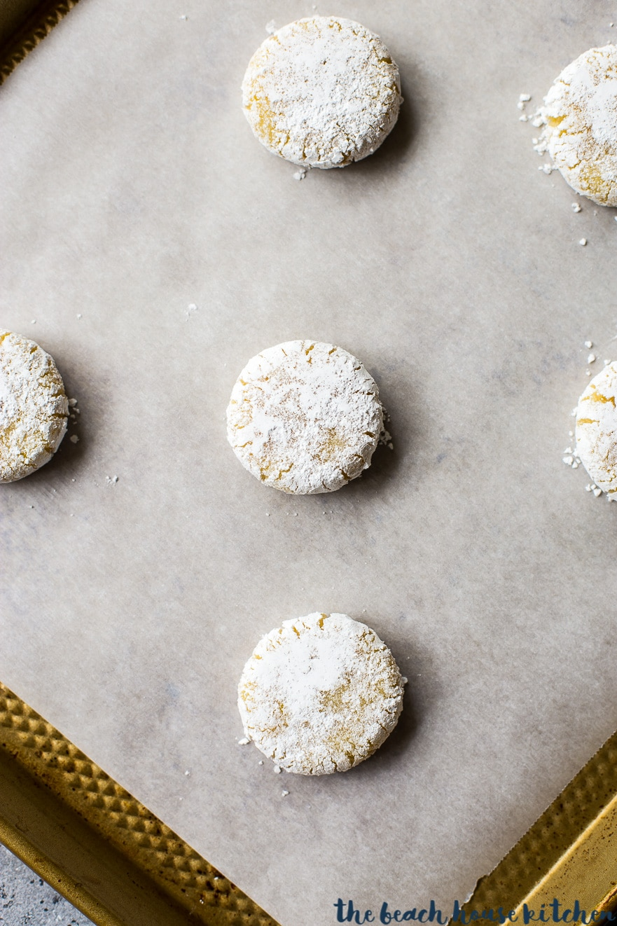 Amaretti cookies on a baking sheet lined with parchment paper