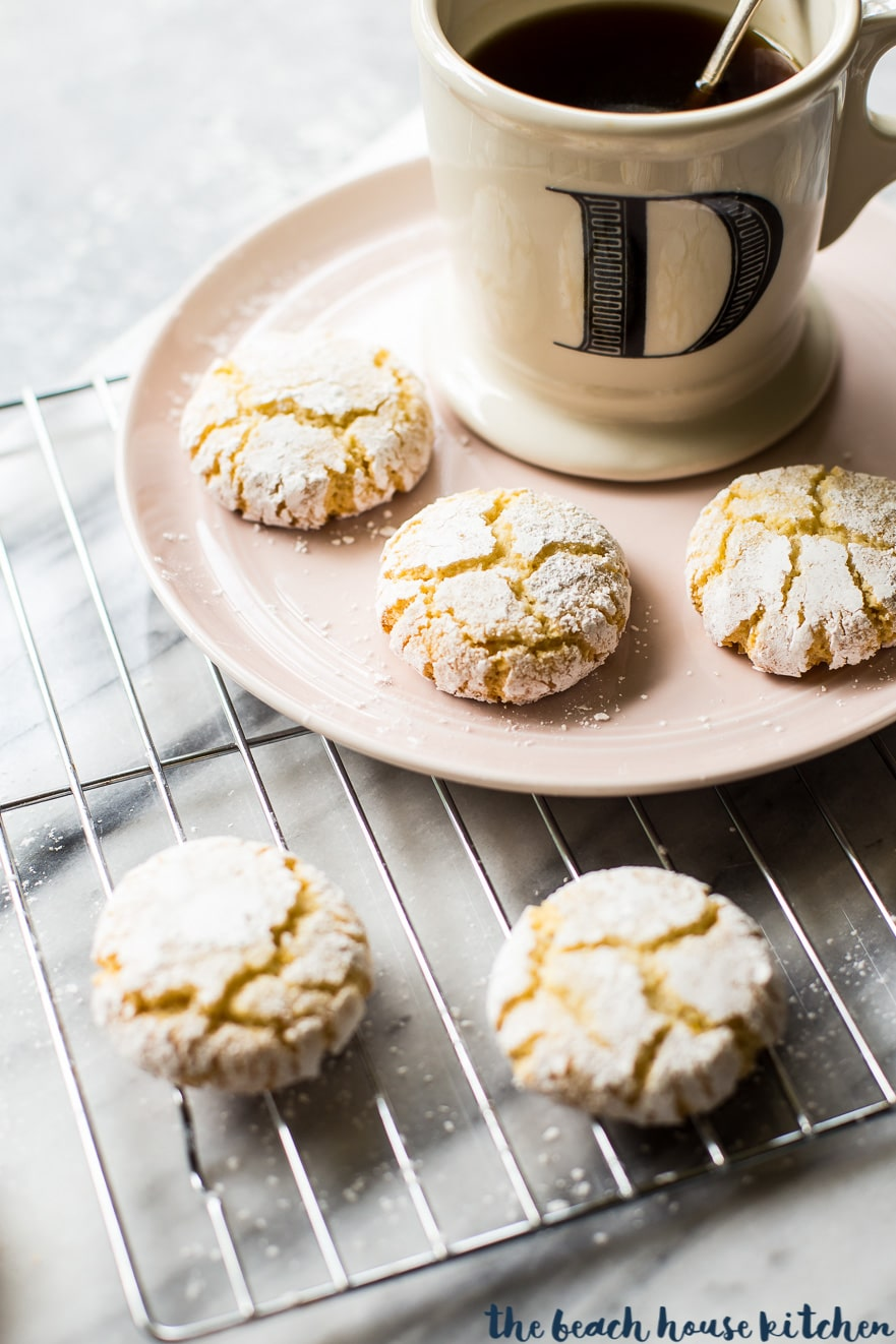 Amaretti cookies on a plate with a cup of coffee