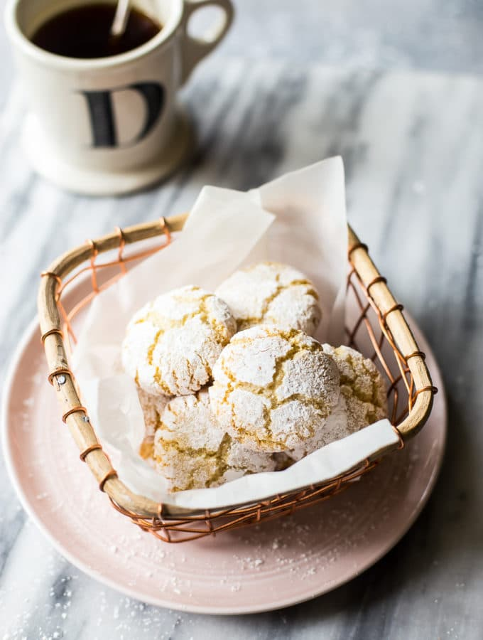 Overhead photo of amaretti cookies in a wire basket