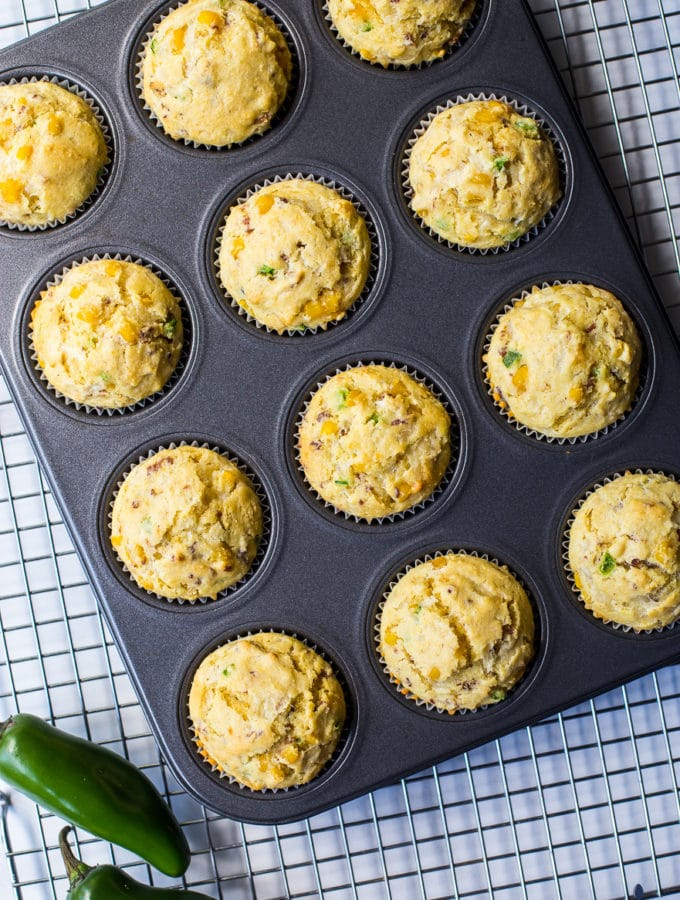 Overhead photo of cheddar bacon jalapeno muffins in muffin pan
