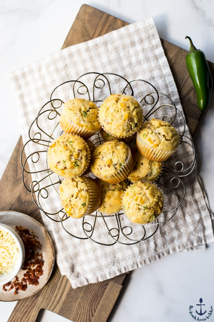 Overhead photo of cheddar jalapeno bacon corn muffins in wire basket