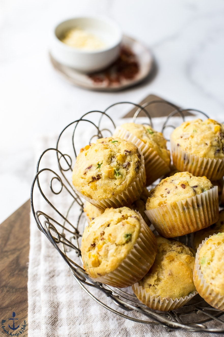 photo of chaddar jalapeno bacon corn muffins in wire basket