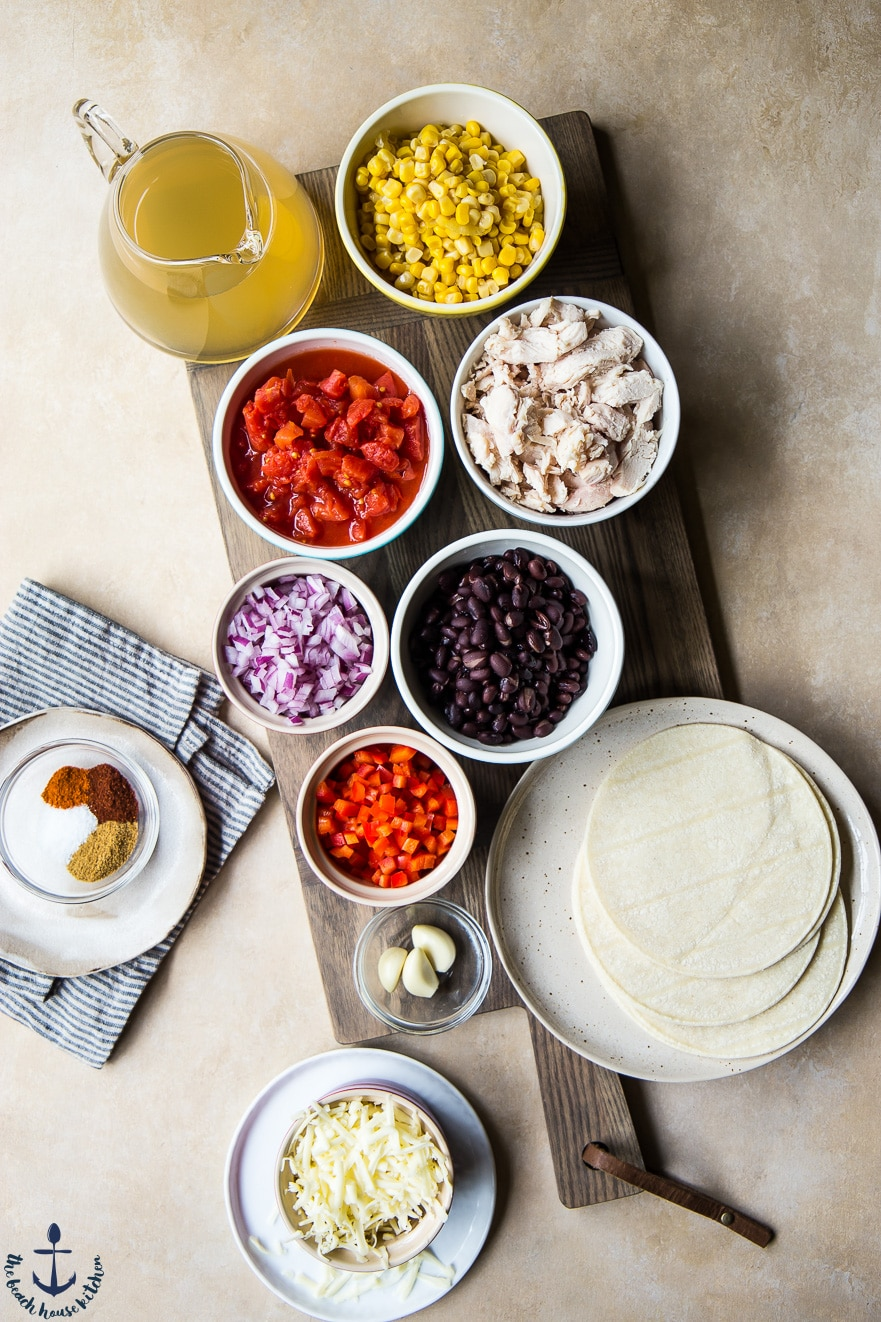 over head photo of ingredients for easy chicken tortilla soup in bowls