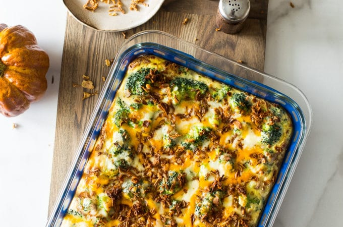 Overhead photo of easy holiday broccoli casserole on a wooden board