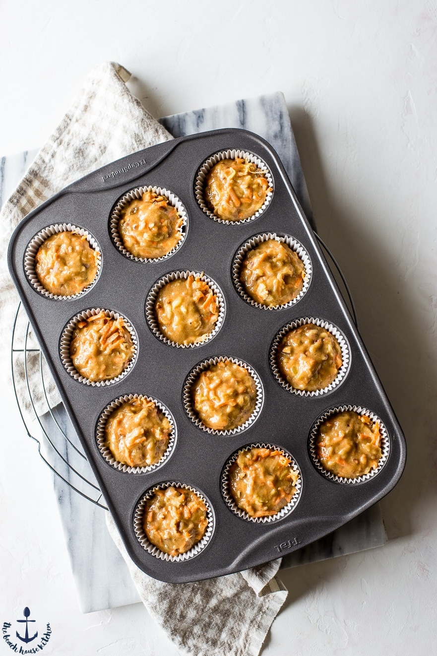 Overhead photo of prebaked morning glory muffins in muffin tin