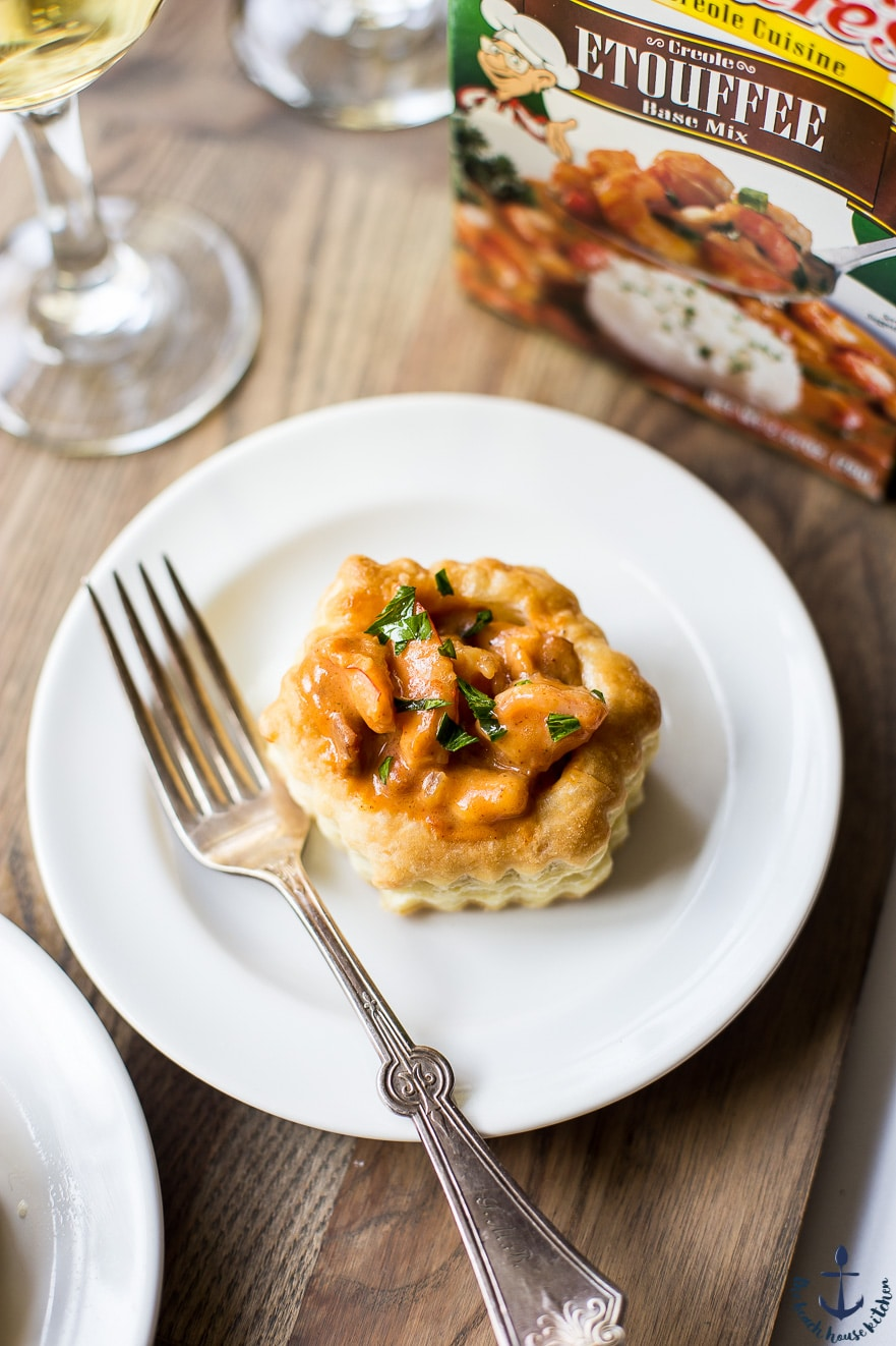 Photo of shrimp etouffee vol au vent on a white plate with a fork