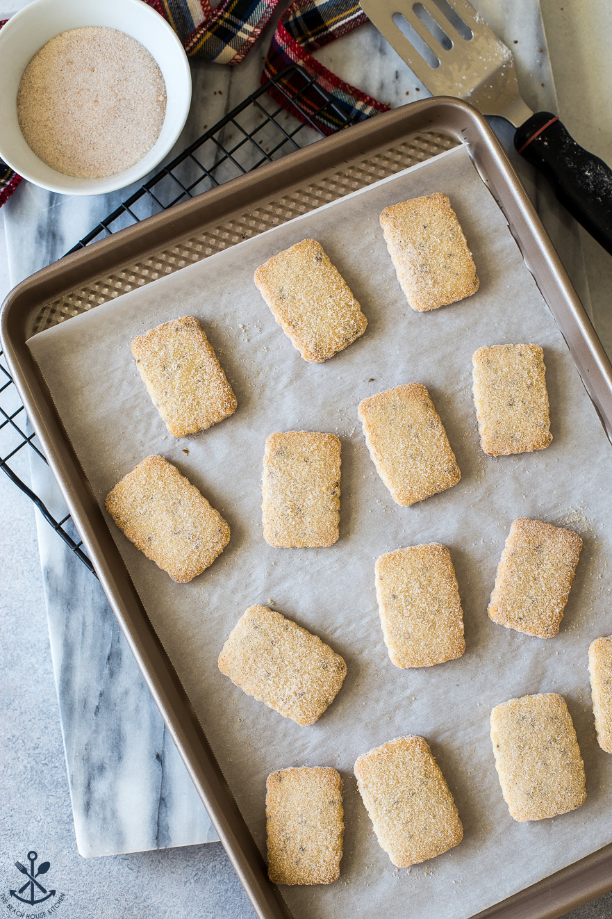 Biscochitos cookies on a gold baking sheet