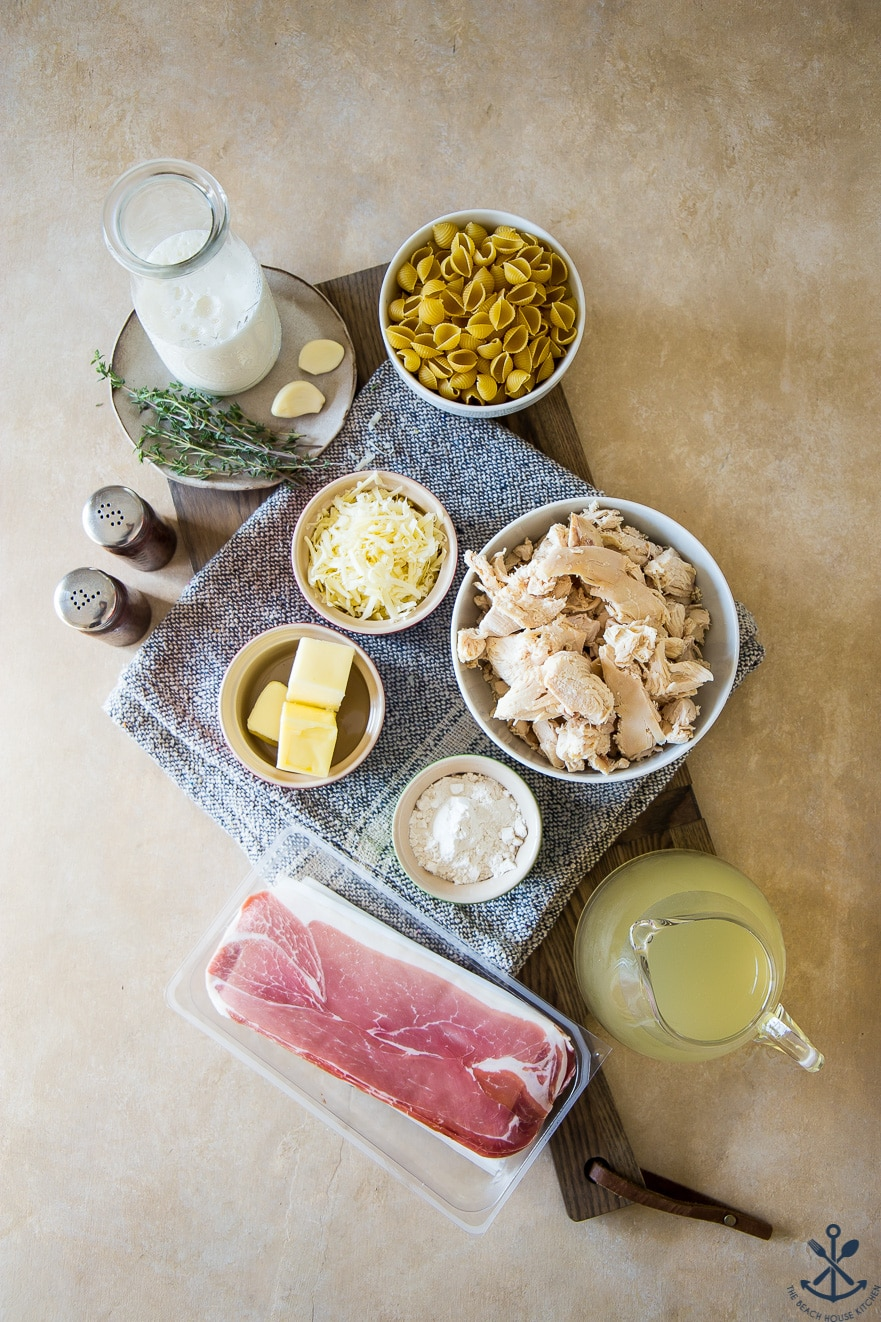 Overhead photo of ingredients for chicken cordon bleu pasta bake in bowls