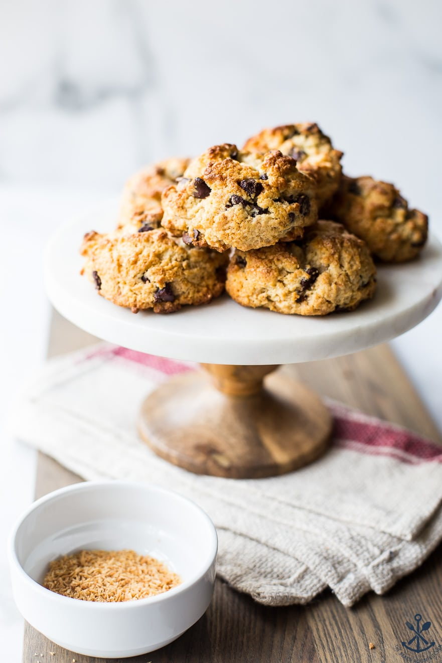 Cake stand topped with chocolate chip toasted coconut scones