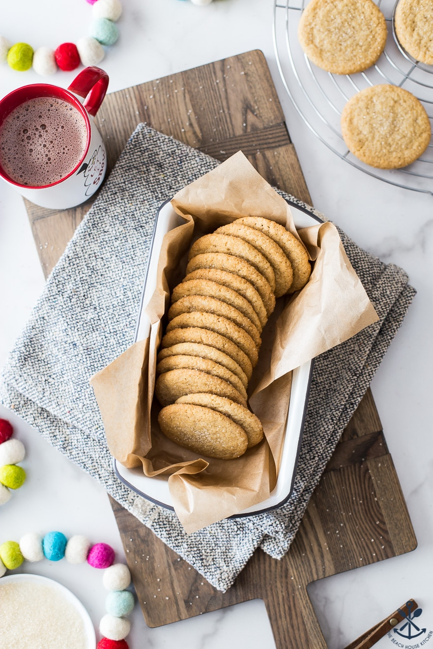 Overhead photo of loaf pan filled with apple pie spice cookies on a wooden board