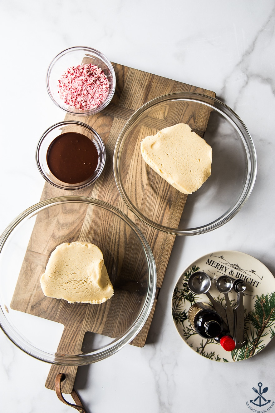 dough for cookies in two glass bowls on a wooden board