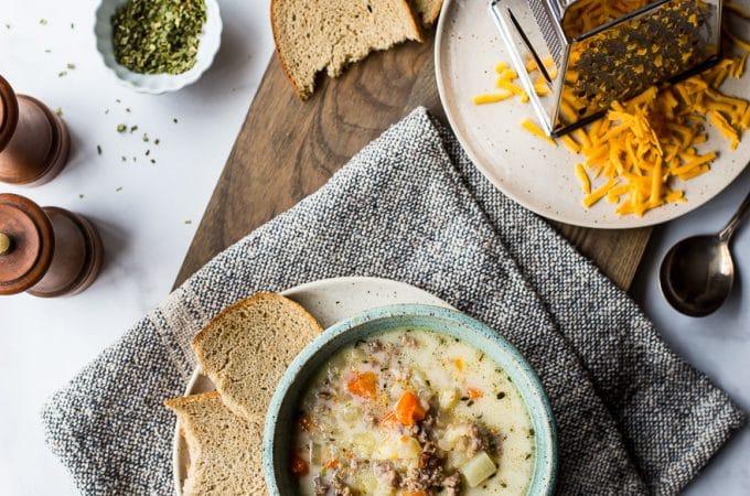 Overhead photo of bowl of slow cooker bratwurst potato soup