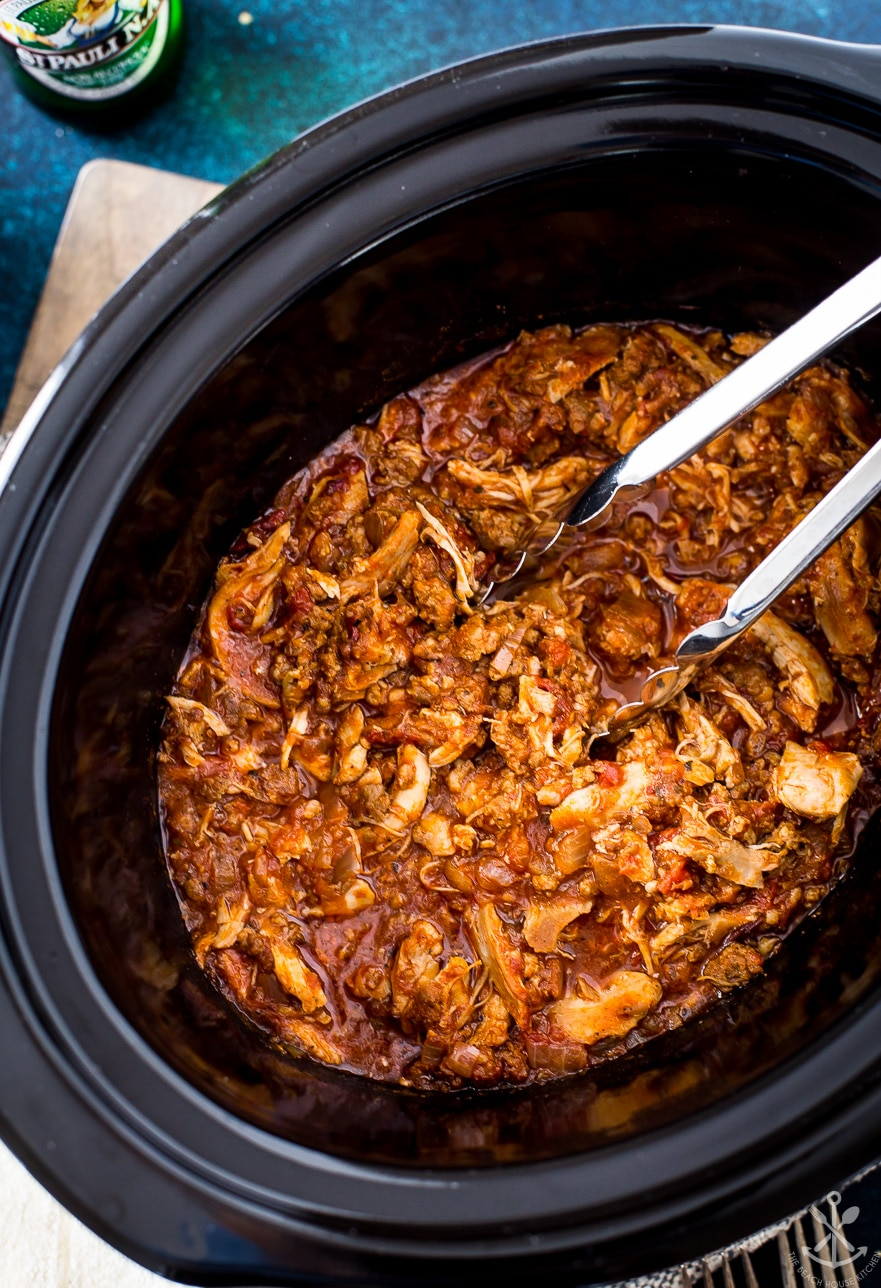 Overhead photo of cooked slow cooker chicken tinga in crock pot