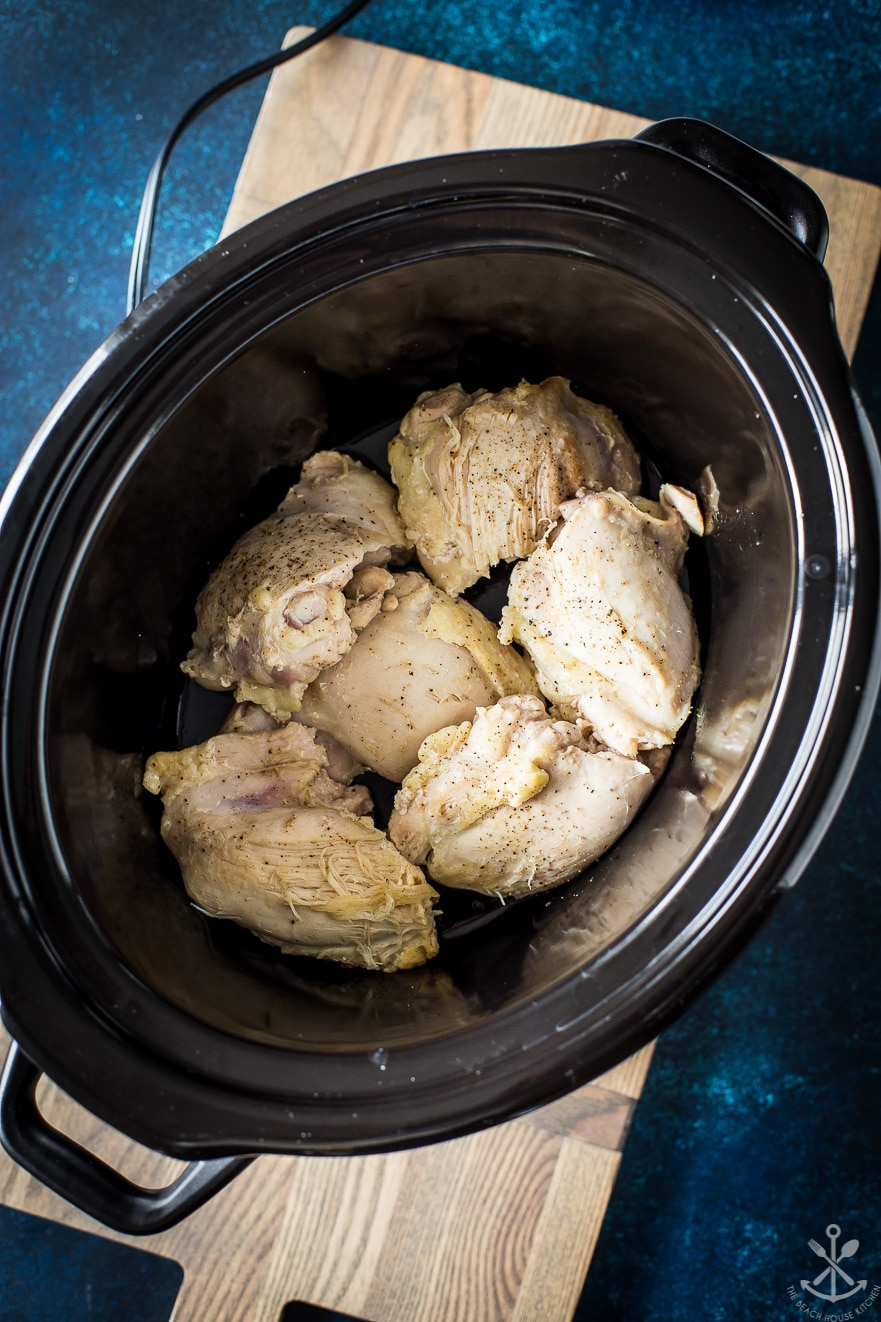 Overhead photo of crock pot filled with chicken thighs